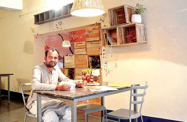 Abhishek at his brainchild, Millet Mama, where  sustainability is the key to his successful venture