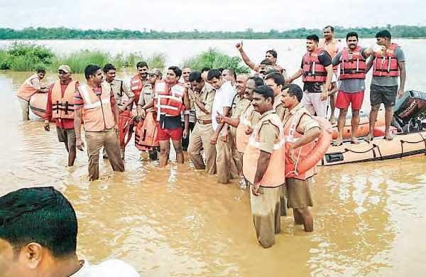 Workers, who got trapped in the flood waters of Vamsadhara river at Purushothapuram village in Srikakulam district, being rescued on Monday | EXPRESS