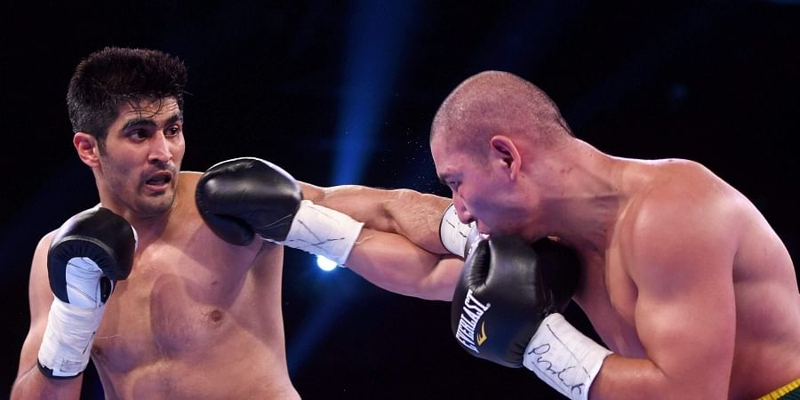 64a1429aac41 Vijender Singh in action against the Chinese boxer Zulpilkar Maimaitiali. |  PTI