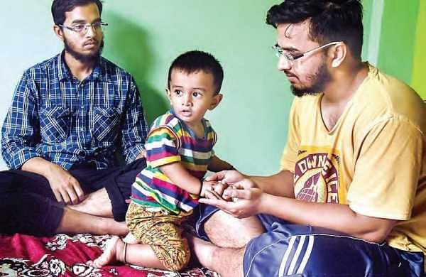 Twin brothers Mohammed Aslam and Mohammed Akram take turns to engage their elder brother Azam's 18-month-old  son, who asks for his father the first thing in the morning | vinay madapu