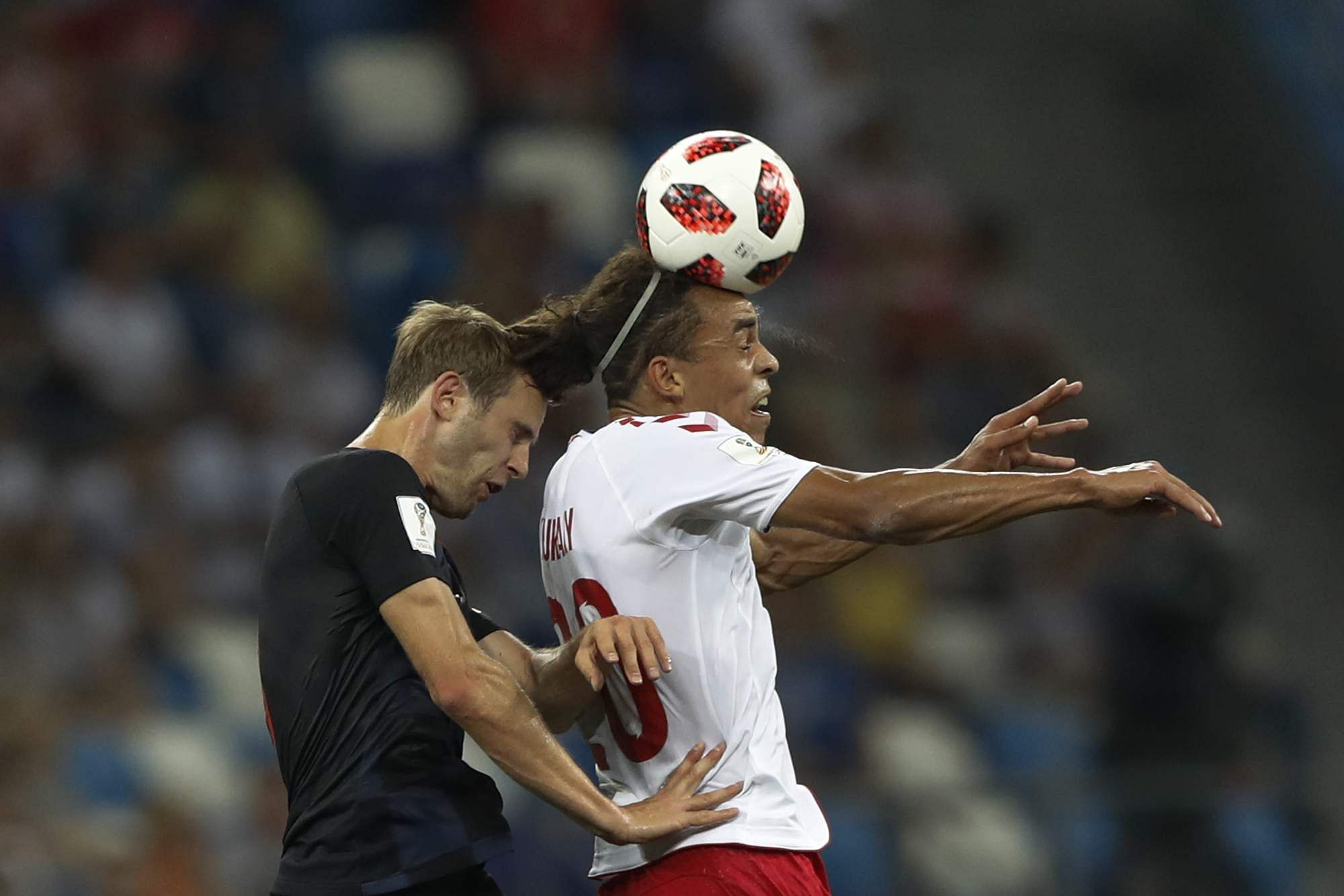 Denmark's Yussuf Yurary Poulsen, right, goes for a header with Croatia's Ivan Strinic during the round of 16 match between Croatia and Denmark at the 2018 FIFA World Cup in the Nizhny Novgorod Stadium, in Nizhny Novgorod, Russia. (Photo | AP)