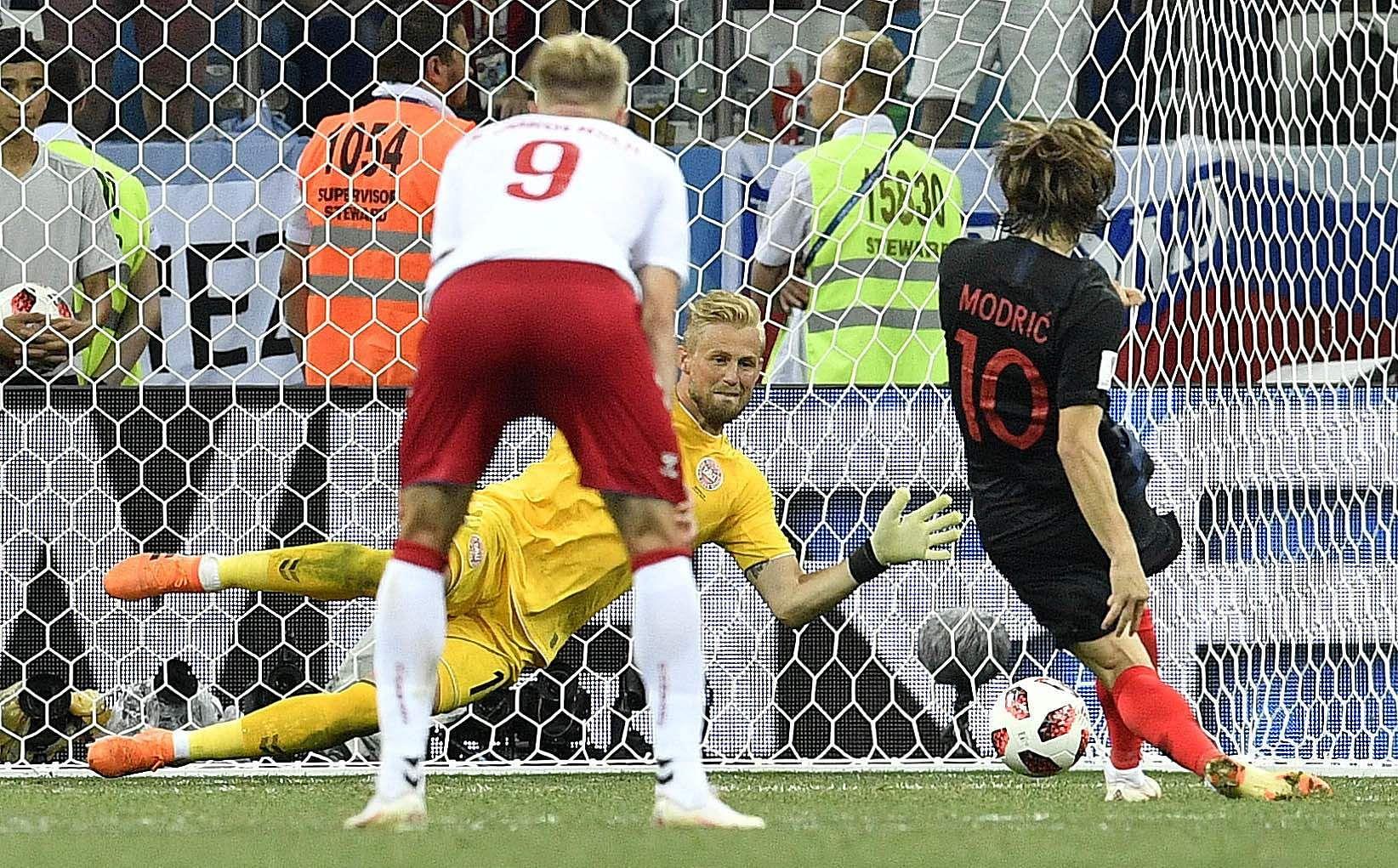 Denmark goalkeeper Kasper Schmeichel saves the penalty kick by Croatia's Luka Modric during the round of 16 match between Croatia and Denmark. (Photo | AP)