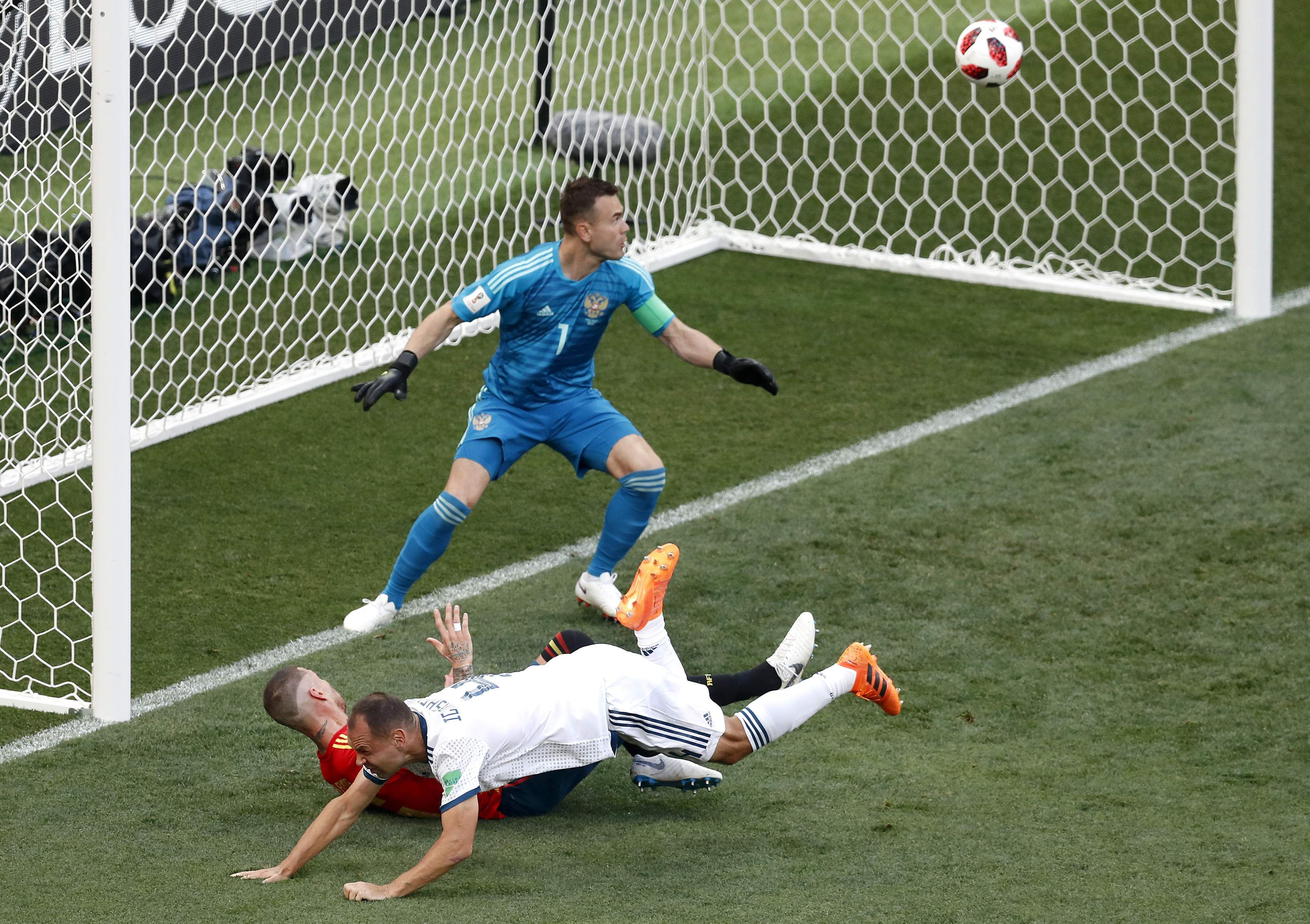 Russia's Sergei Ignashevich, front, scores an own goal during the round of 16 match between Spain and Russia. (Photo | AP)