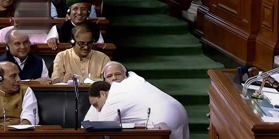 Congress President Rahul Gandhi hugs Prime Minister Narendra Modi after his speech in the Lok Sabha on 'no-confidence motion' during the Monsoon Session of Parliament in New Delhi. (Photo | PTI)