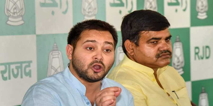 RJD leader Tejashwi Yadav speak to the media during a press conference in Patna. (File Photo | PTI)