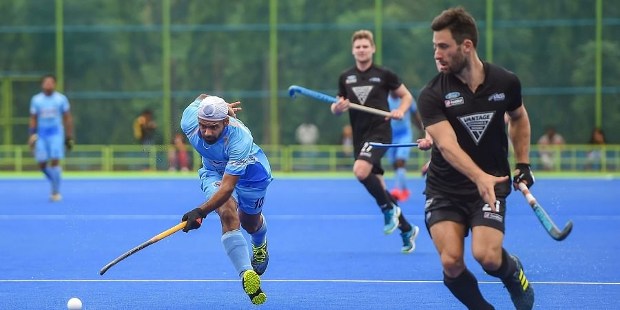 Indian hockey player Simranjeet Singh and New Zealand players vies for the ball during the 2nd hockey match of the three test match series at Sports Authority of India in Bengaluru. (Photo| PTI)