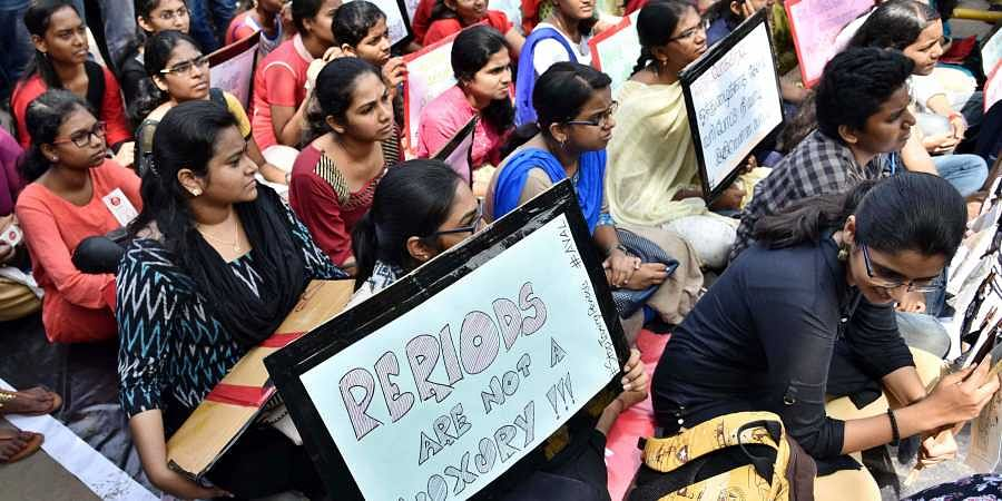 Sanitary pads exempt from GST, tax cut on TV, shoes