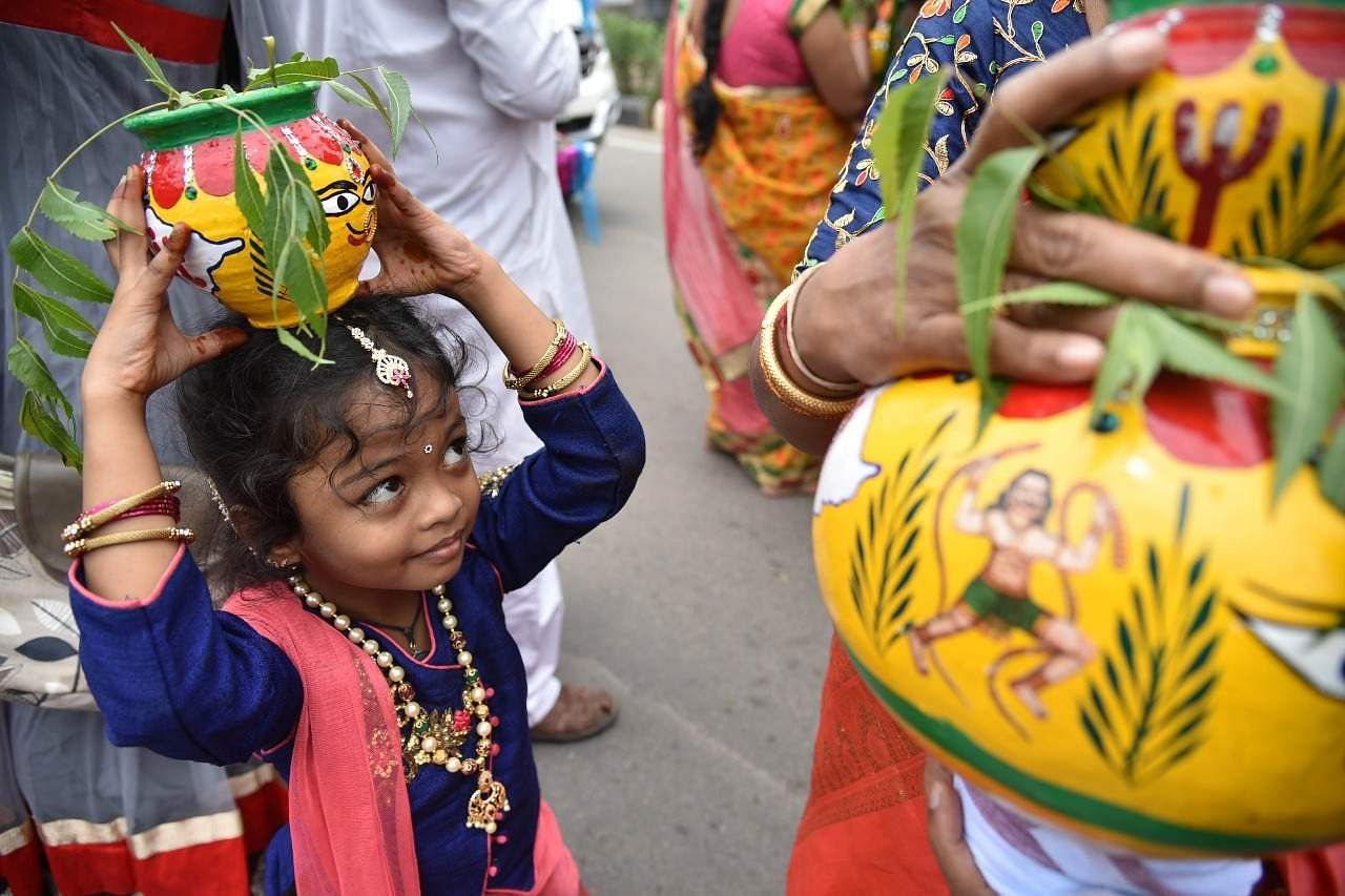 Colours of Bonalu leave a spectacle for Hyderabadis- The New