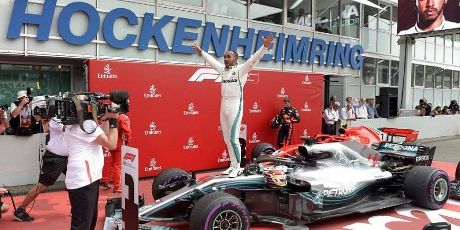 Mercedes driver Lewis Hamilton of Britain celebrates after winning the German Formula One Grand Prix at the Hockenheimring racetrack in Hockenheim, Germany. (Photo | AP)