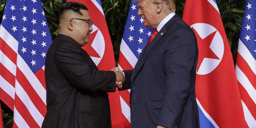 U.S. President Donald Trump shakes hands with North Korea leader Kim Jong Un at the Capella resort on Sentosa Island Tuesday, June 12, 2018 in Singapore. | AP
