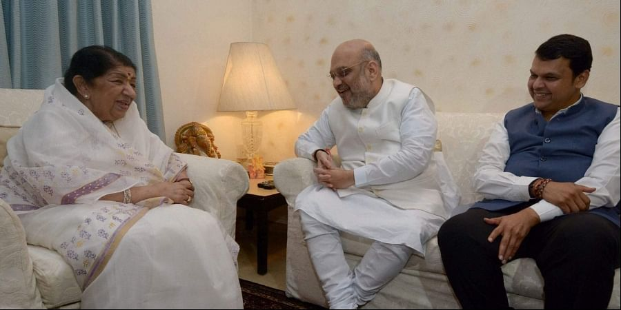 BJP President Amit Shah and Maharashtra Chief Minister Devendra Fadnavis meet singer Lata Mangeshkar during party's 'Sampark for Samarthan' campaign to generate awareness about the NDA government's achievements in Mumbai. (Photo | PTI)
