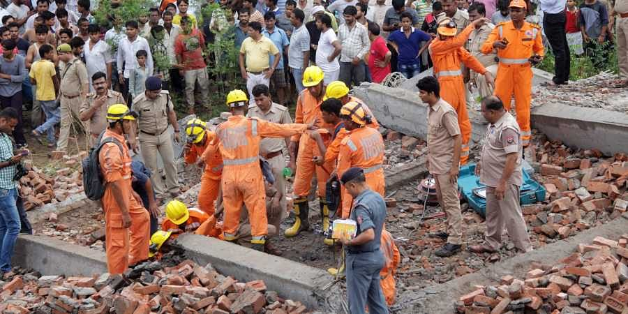 Rescue works underway after an under-construction building collapsed at Masuri in Ghaziabad on Sunday July 22 2018. | PTI