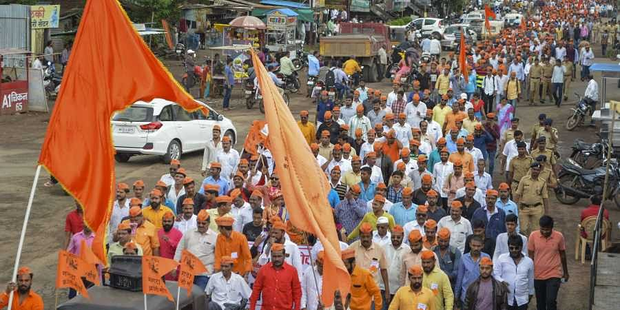 Protestors from the Maratha community take part in a rally demanding reservation in Karad Maharashtra on Tuesday. (Photo | PTI)