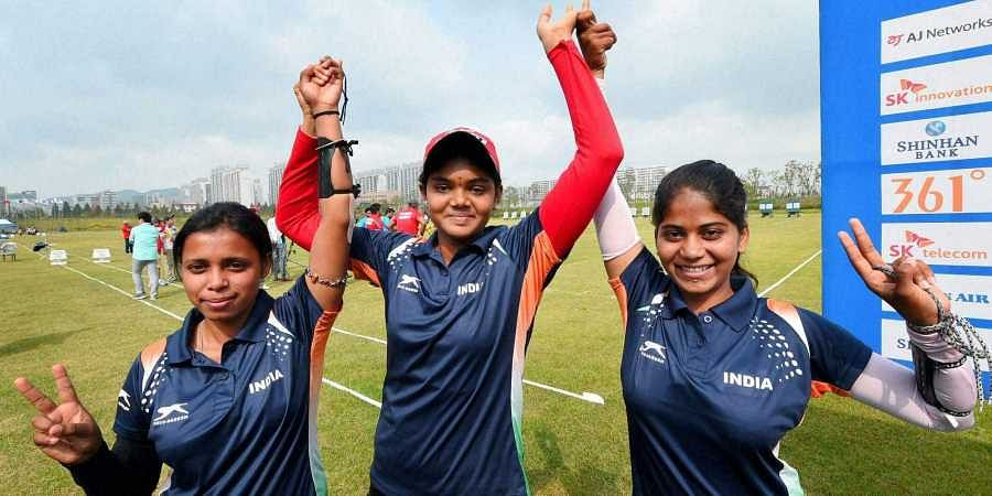 Bronze medal winning Women's compound archery team members Jyothi Surekha  Vennam, Purvasha Sudhir Shende and Trisha Deb pose after the final at the  17th ...