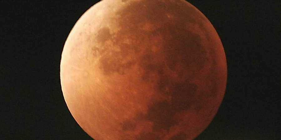 Skygazers revel in blood moon, cloud hinders Delhis view