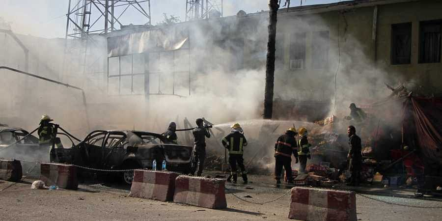 Police and firemen work at the site of a deadly suicide attack in Jalalabad, Afghanistan (File Photo | AP)