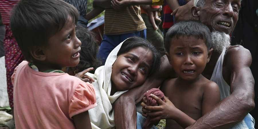 A group of Muslim Rohingyas in Ghumdhum, Cox's Bazar weep as Bangladesh border guards (not pictured) order them to leave their makeshift camp and force them out of the country on August 28, 2017. Since 2012, more than 1,000 Rohingya have been killed, some 320,000 live in squalid camps in Myanmar and neighboring Bangladesh, and thousands have embarked on perilous sea voyages to other Southeast Asian countries, according to estimates by the U.S.-based Human Rights Watch and the United Nations. (Photo | AP)