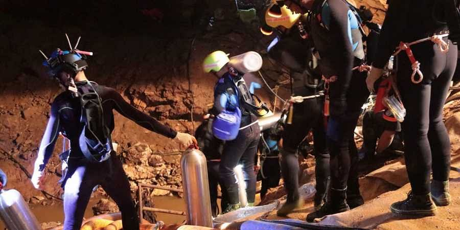 Amid jubilation, four more boys rescued from flooded Thai cave