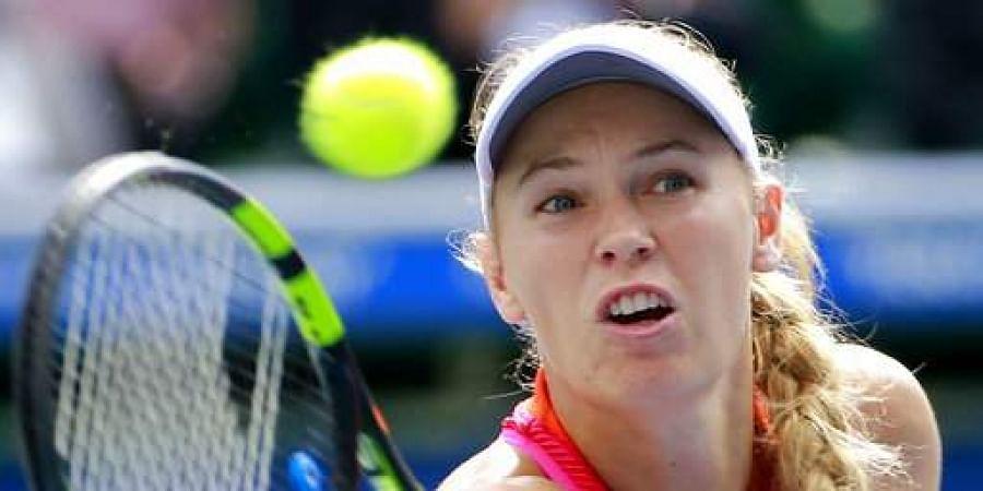 Second-ranked Wozniacki withdraws with right leg injury