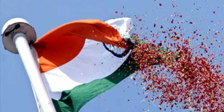 A tri colour flag being unfurled during the Independence Day celebrations. (File | EPS)