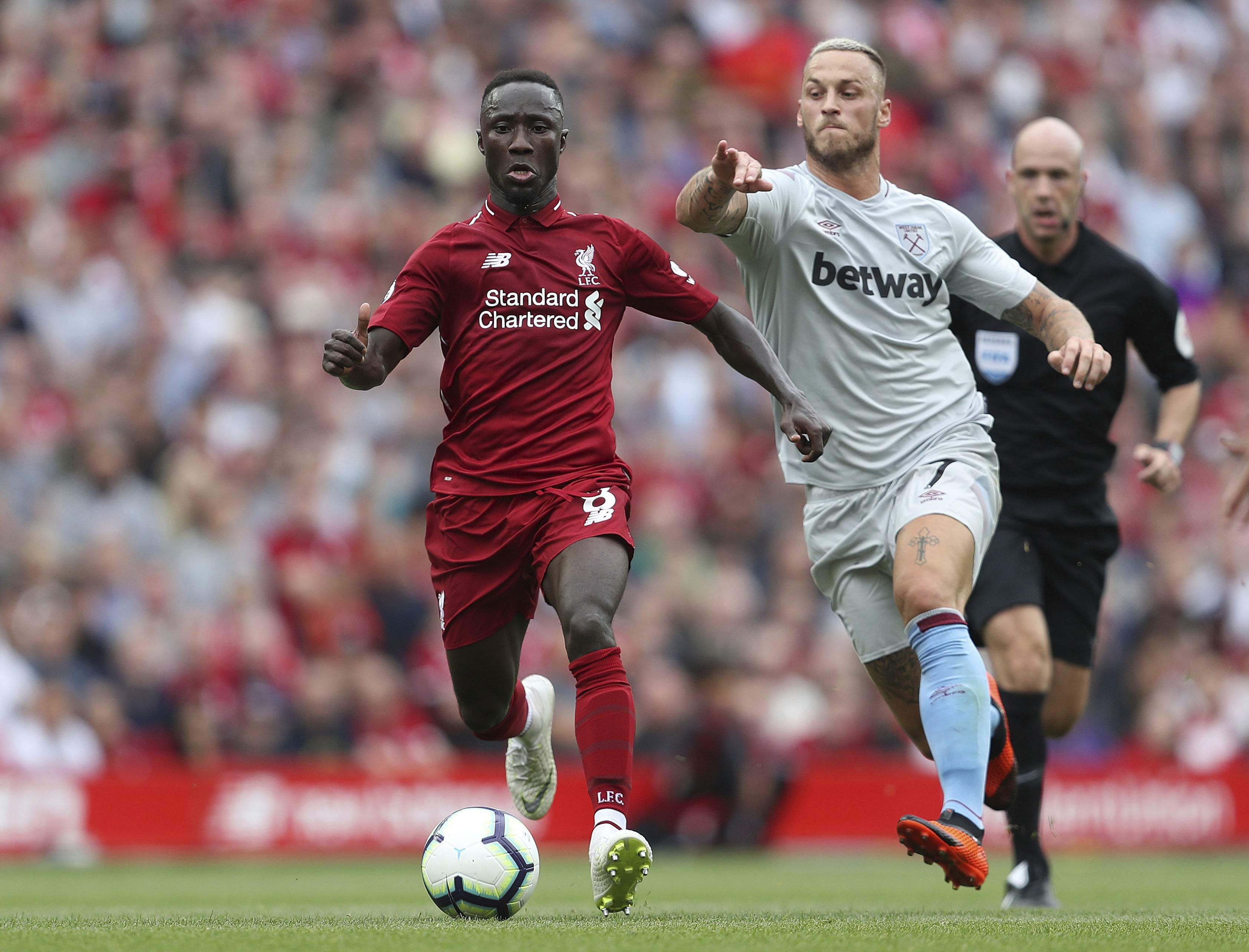 Liverpool's Naby Keita, left,and West Ham United's Marko Arnautovic battle for the ball. (Photo | AP)