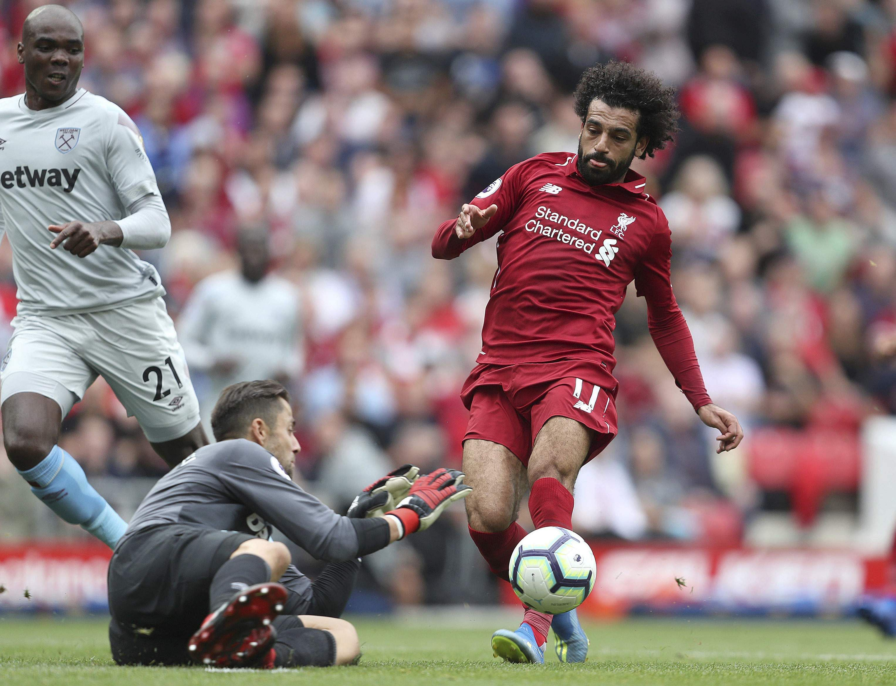 West Ham United goalkeeper Lukasz Fabianski makes a save from Liverpool's Mohamed Salah. (Photo | AP)