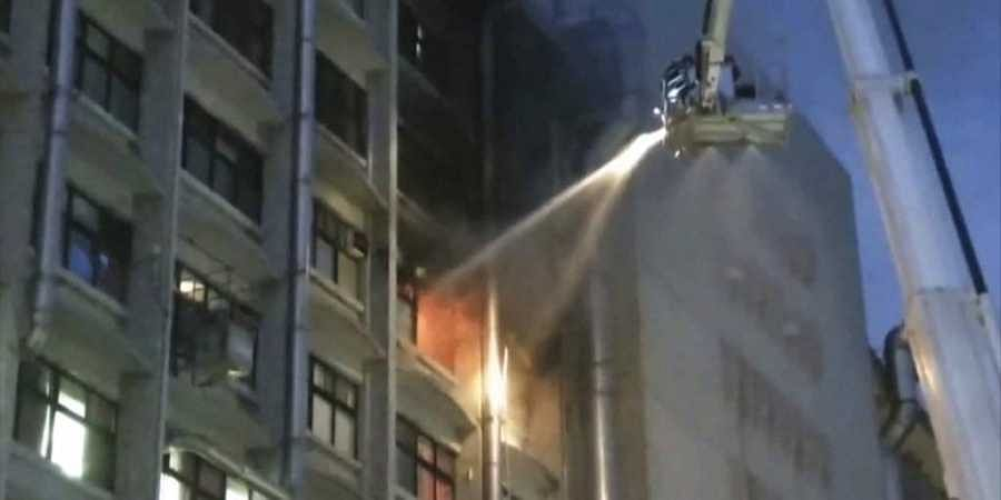 In this image from a video, firefighters try to extinguish fire at Taipei Hospital of the Ministry of Health and Welfare in New Taipei City, Taiwan Monday, Aug. 13, 2018. (Photo | AP)