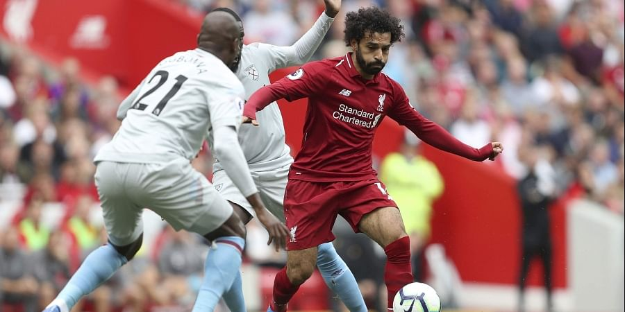 Liverpool's Mohamed Salah, right, dribbles the ball during the Premier League match at Anfield, Liverpool. (Photo | AP)