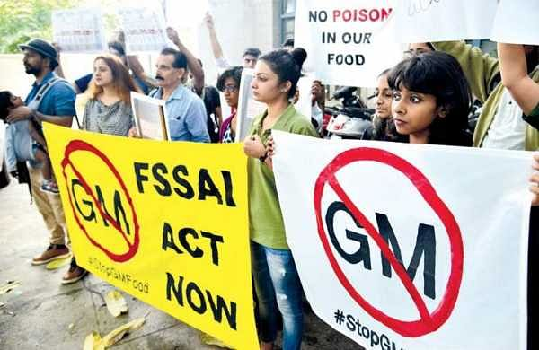 Protesting activists demand removal of genetically modified food products from markets outside the FSSAI office in Bengaluru on Monday | Pushkar V