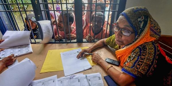 People wait in a queue to check their names on the final draft of the state's National Register of Citizens after it was released at an NRC Seva Kendra in Assam. (File | PTI)