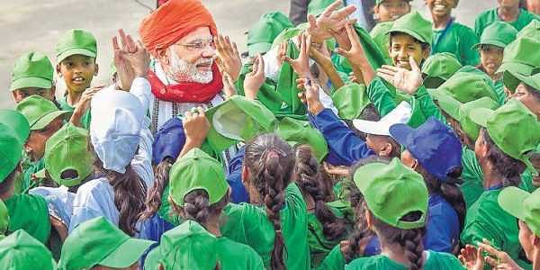 Prime Minister Narendra Modi interacts with children during the Independence Day celebrations at the Red Fort, in New Delhi on Wednesday   PTI