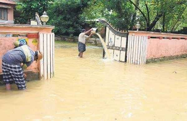 Residents cleaning their houses which were flooded in the rain at Palakkadavu in Neyyatinkara. Water levels are yet to recede in the region which was inundated on Tuesday evening  B P Deepu