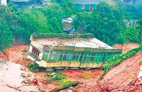 A two-storey house situated on a hill-top near Muttappa Temple in Madikeri slid down along with the mud during a landslide on Thursday. No one was inside the building at the time of the incident | EXPRESS