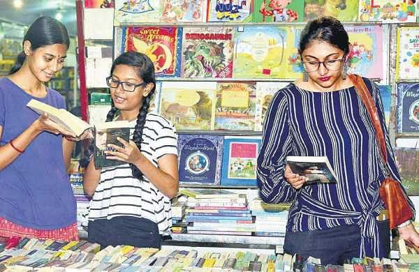 Visitors browse books at one of the stalls set up at the Chennai Book Fair in YMCA, Royapettah, on Friday |  Martin Louis