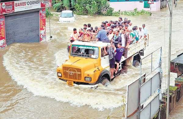 A tipper lorry filled with people rescued from various localities of Maravanthuruthu and Thalayolaparambu panchayats wading through the flood   VISHNU PRATHAP