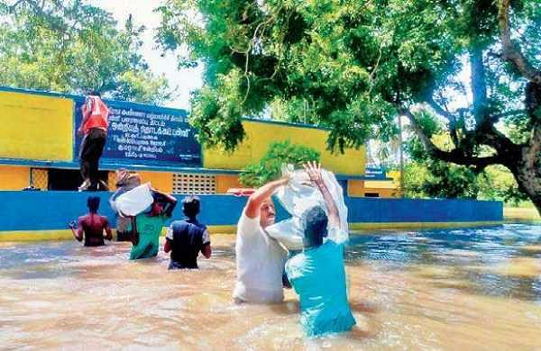 Rescue operations in progress in Chidambaram on Saturday. More than 20 people were rescued from villages along Cauvery river   Express