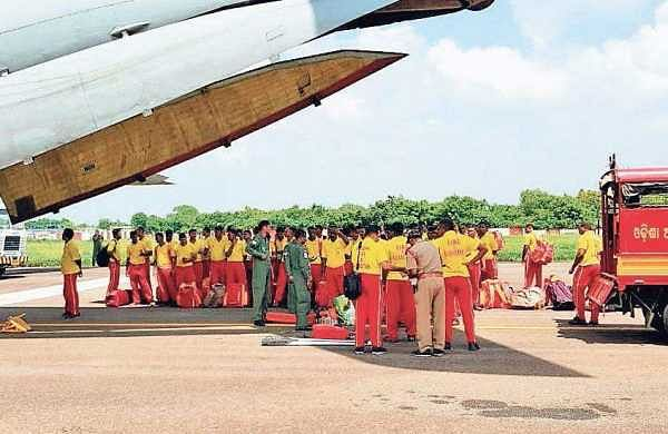 Odisha fire service personnel boarding a special aircraft to assist in rescue operations in flood-hit Kerala, in Bhubaneswar on Saturday   Express