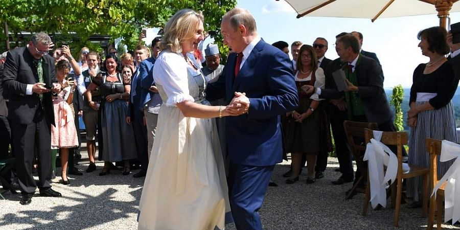 Russian President Vladimir Putin, right, congratulates Austrian Foreign Minister Karin Kneissl as he attends the wedding of Kneissl with with Austrian businessman Wolfgang Meilinger in Gamlitz, southern Austria. (Photo | AP)