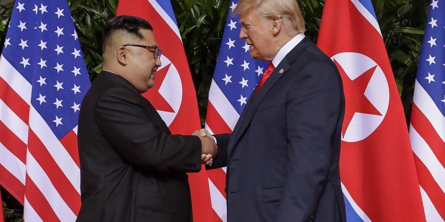 U.S. President Donald Trump shakes hands with North Korea leader Kim Jong Un at the Capella resort on Sentosa Island Tuesday, June 12, 2018 in Singapore. | AP