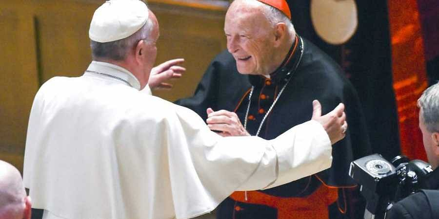 FILE - In this Sept. 23, 2015 file photo, Pope Francis reaches out to hug Cardinal Archbishop emeritus Theodore McCarrick after the Midday Prayer of the Divine with more than 300 U.S. Bishops at the Cathedral of St. Matthew the Apostle in Washington. (Pho