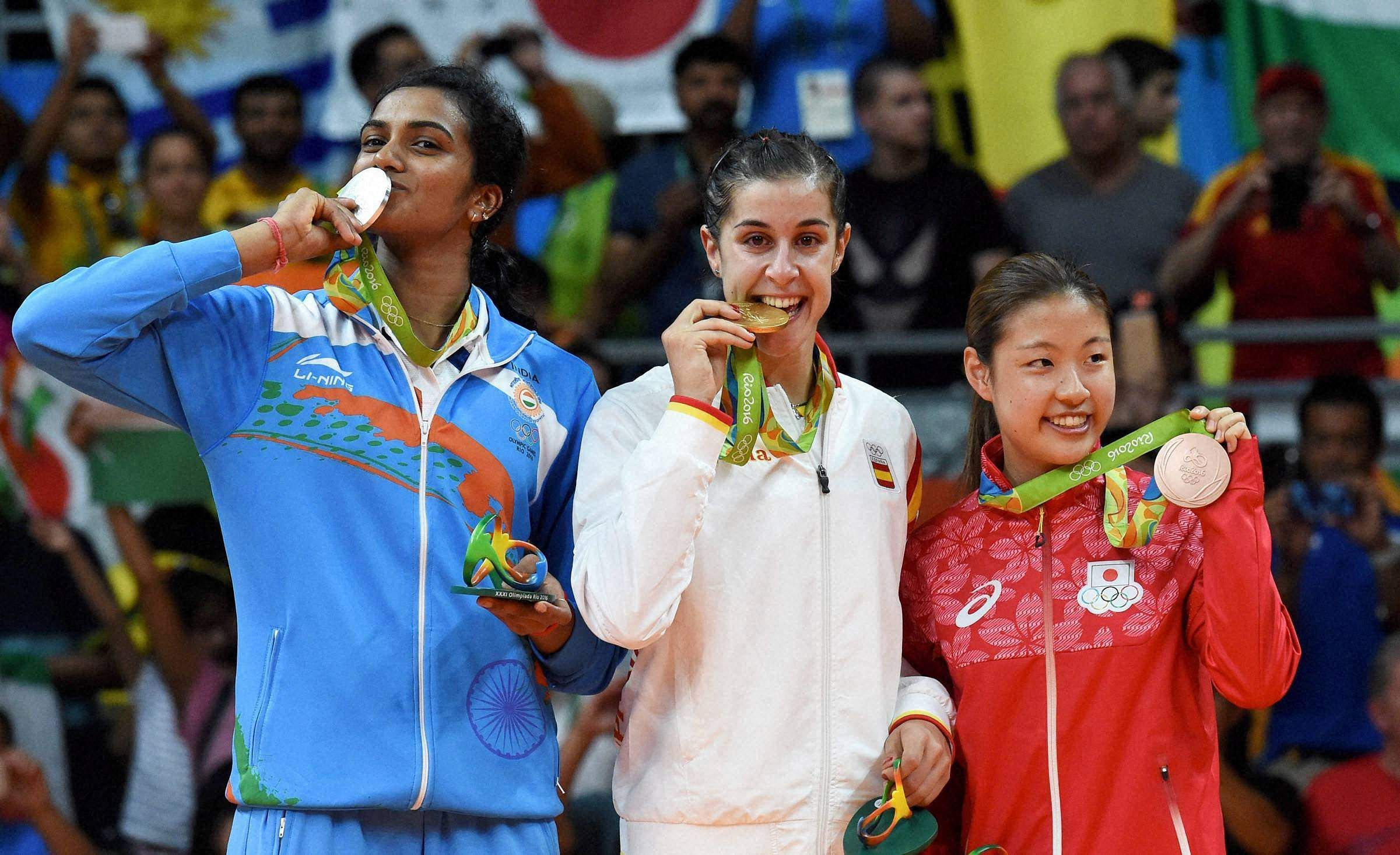 OLYMPICS 2016: While she achieved the historic feat of becoming the first-ever Indian to win a silver medal in badminton in the Olympics, PV Sindhu (Left) lost a tight three-setter final. Spain's Carolina Marin (Centre) became the first non-Asian woman to win badminton singles Olympic gold by beating Sindhu 19-21 21-12 21-15 in the final in Rio. (Photo | AP)