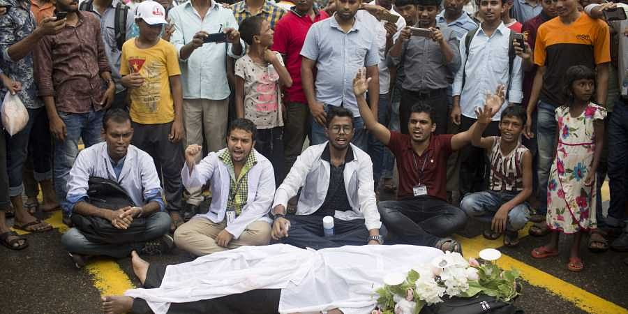 Protesters paralyze parts of Bangladesh after a speeding bus kills two students