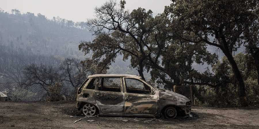 A burnt car sits on the outskirts of the village of Monchique in southern Portugal's Algarve region. (Photo | AP)
