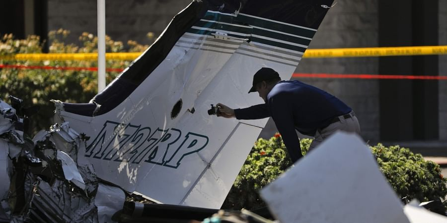 An investigator surveys the wreckage of a twin-engine aircraft that crashed on Sunday near the South Coast Plaza shopping center Monday, Aug. 6, 2018, in Santa Ana, Calif. (Photo | AP)