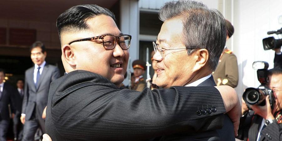 North Korean leader Kim Jong Un,  and South Korean President Moon Jae-in