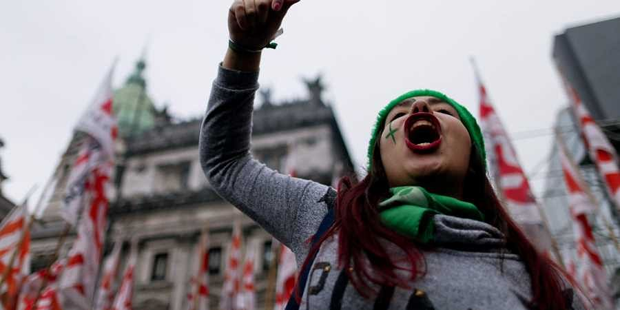 A demonstrator in support of decriminalizing abortion shouts outside Congress in Buenos Aires, Argentina. (Photo | AP)