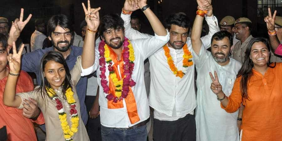 ABVP's panel's newly elected DUSU President Ankiv Basoya 3rd R Shakti Singh Vice President and Joint Secretary Jyoti Choudhary L celebrate after DUSU Election Result 2018 in New Delhi. (Photo | PTI)