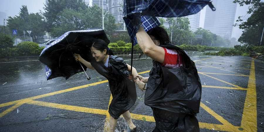 More than 60 dead as Mangkhut continues into southern China