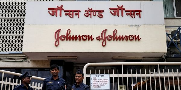 Security guards stand outside the office of Johnson & Johnson in Mumbai. (Photo | Reuters)