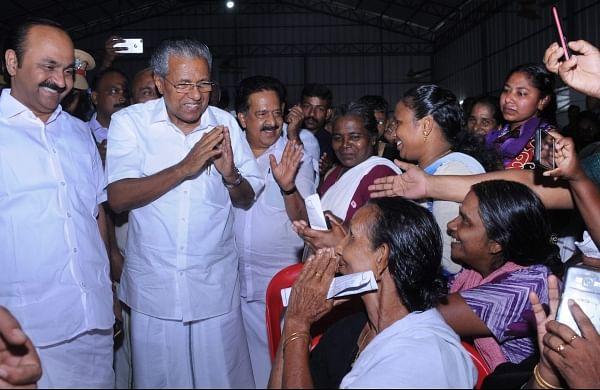 In this file photo, Chief minister Pinarai Vijayan, Opposition leader Ramesh Chennithala and Paravoor MLA V D Sathisan visits the relief camp at Manjali, Kochi. ( Photo | EPS)